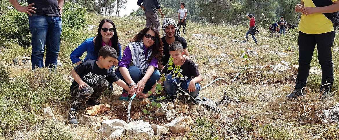 Minister H.E. Atteereh at the planting activity in Wadi Al-Quff